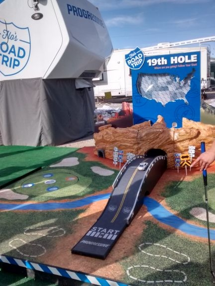 Golfing for prizes at Progressive booth